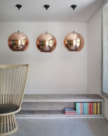 Discreet and practical storage that doubles as seating in the DM House designed by guilhermetorres.com.