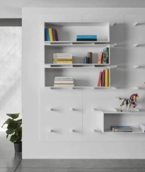 The Dots bookshelf from arisarchitects.com. Storage and a feature wall in one.