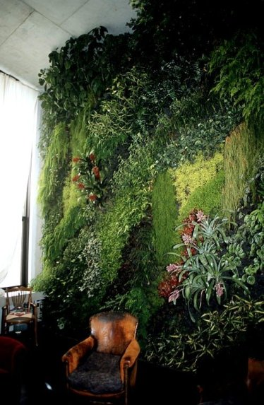The vertical living room garden comes courtesy of world=renown www.verticalgardenpatrickblanc.com