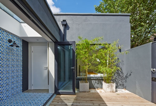 1. An outdoor-indoor garden area in a renovated mews in London's Hackney.