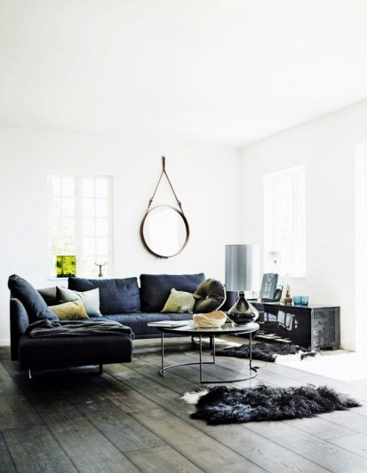 A modern and moody dark Scandi living room on mydomaine.com